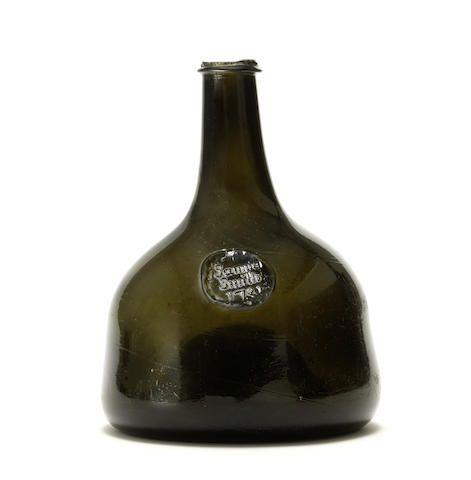 A sealed mallet wine bottle, dated 1731