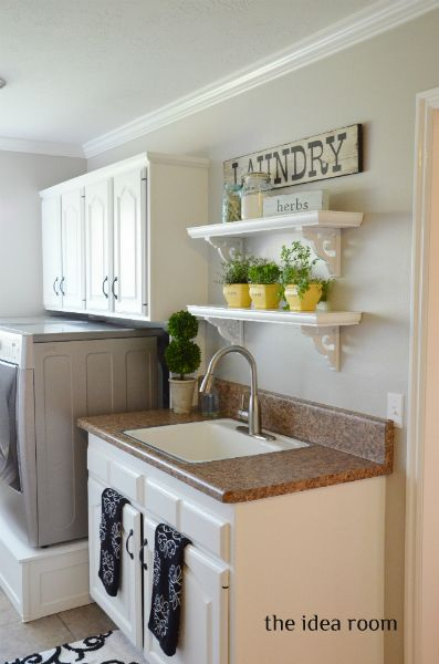 I love the colors in this simple laundry room