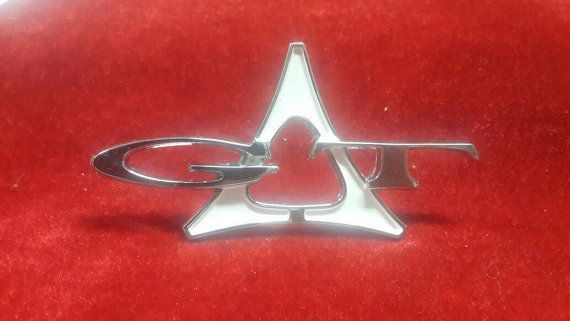 Check out this item in my Etsy shop https://www.etsy.com/listing/489060441/1963-1966-dodge-dart-gt-emblem-set