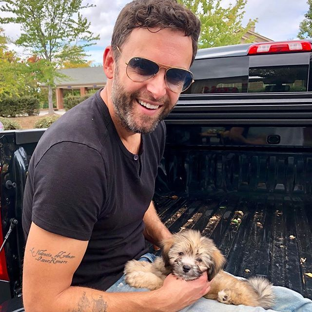 Hot man, adorable pup and a sweet truck