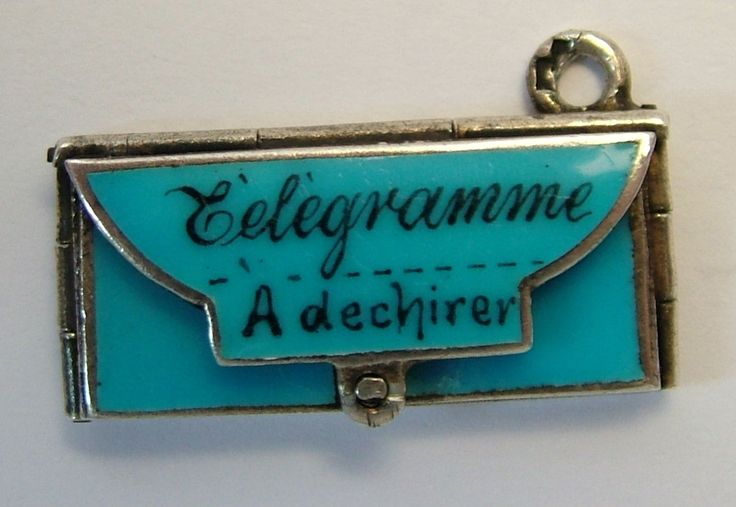French telegram charm that opens to say 'I love you' inside.