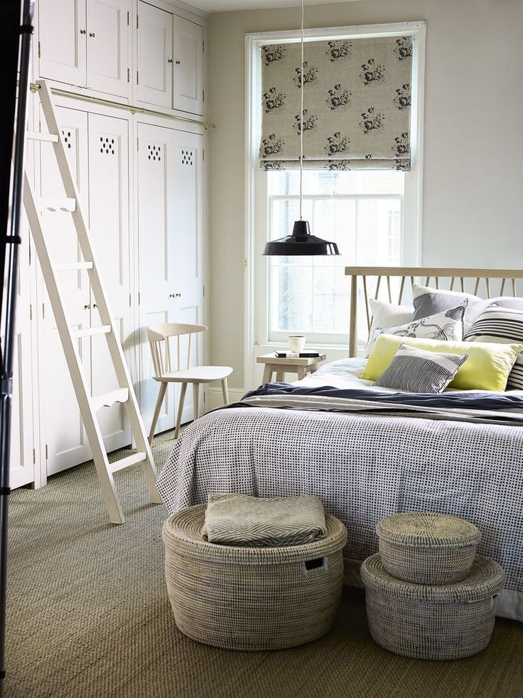 Woven seagrass flooring with rustic basketware and herringbone linens give the room a natural feel. Photography: Dan Duchars. Find more bedroom ideas at housebeautiful.co.uk
