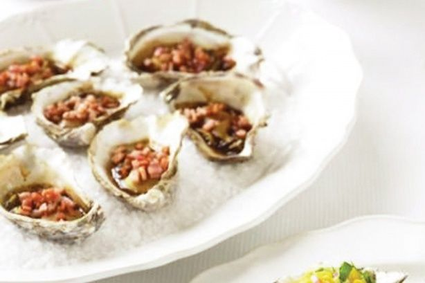 Natural oysters are given a flavour boost with sweet balsamic, crispy bacon and a squeeze of fresh tangy lemon. This is a FODMAP friendly recipe for a Low FODMAP diet.