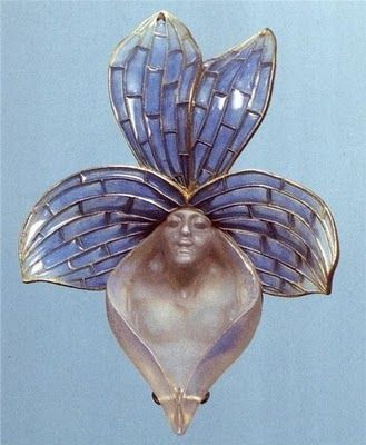 Lalique 'Orchid' Pendant 1899-1900: blossom has 4 pale blue plique-à-jour enamel & gold petals; the 5th, or bottom, petal of molded frosted glass depicts the bust of a woman: signed on the top right leaf: LALIQUE: museo.gulbenkian.pt