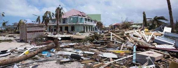 TOPSHOT - A photo taken on September 7, 2017 shows damage in Orient Bay on the French Carribean island of Saint-Martin, after the passage of Hurricane Irma. France, the Netherlands and Britain on September 7 rushed to provide water, emergency rations and rescue teams to territories in the Caribbean hit by Hurricane Irma, with aid efforts complicated by damage to local airports and harbours. The worst-affected island so far is Saint Martin, which is divided between the Netherlands and France…