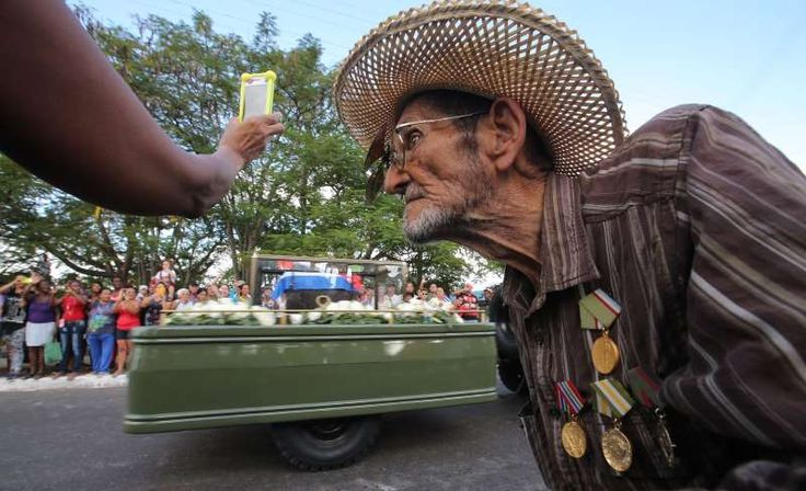 Fidel Castro's ashes travel across Cuba:   Guillermo Enrique Cadiz, 82, who fought with Fidel Castro in the Sierra Maestra, watches as Castro's ashes pass him in Jovellanos, Cuba.