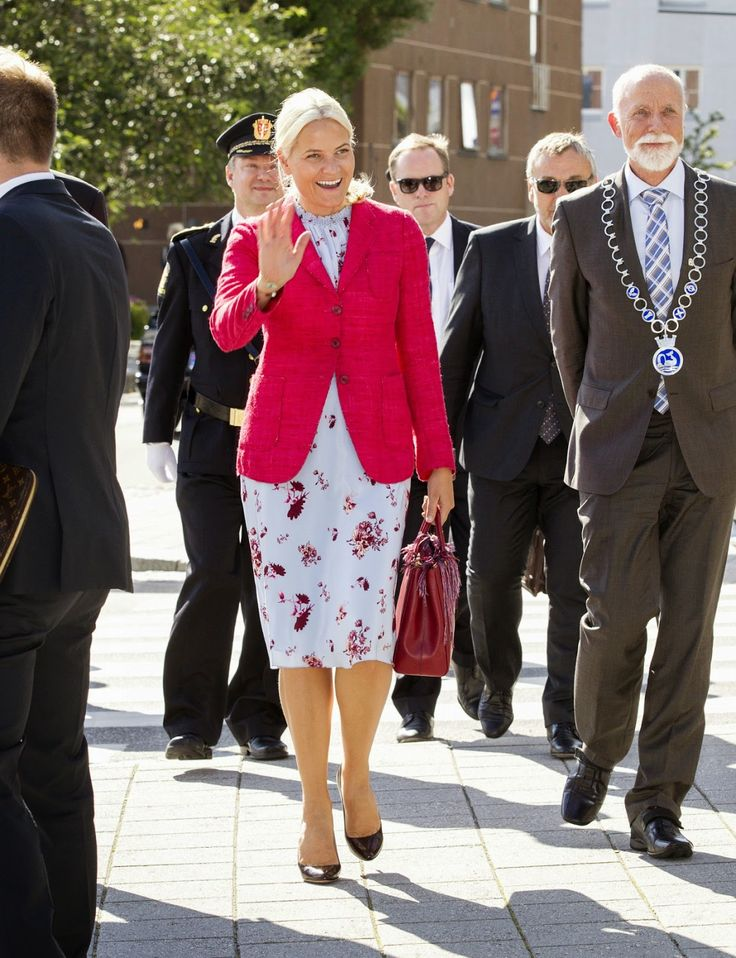 Crown Princess Mette-Marit in her sky blue Pia Tjelta dress by TiMo, she matched her dress with a bright pink jacket.