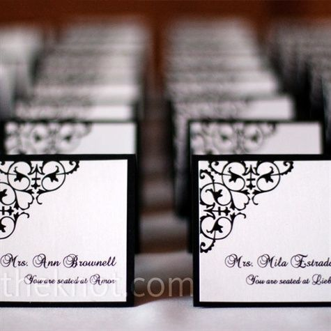 The square, tented escort cards were black and white with the wedding's signature black scroll design.