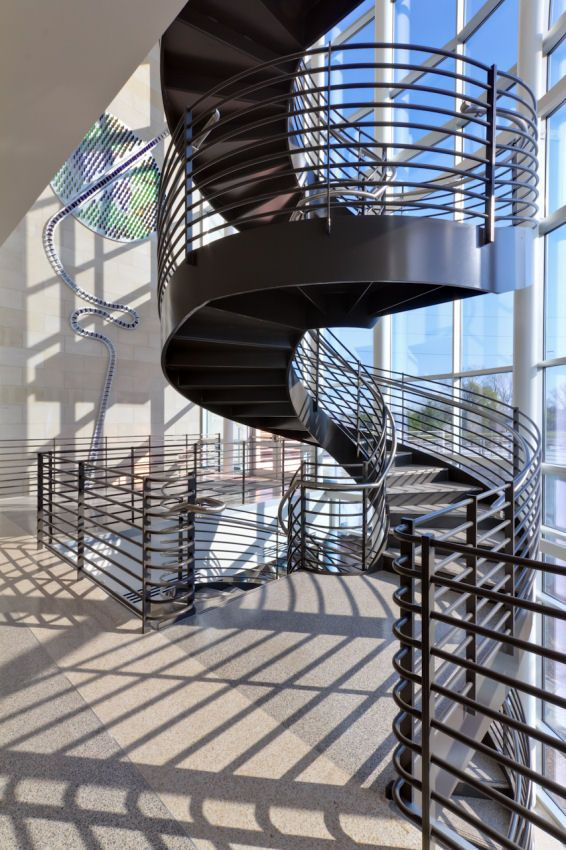 Commercial Spiral Staircase With Metal And Stone Components.