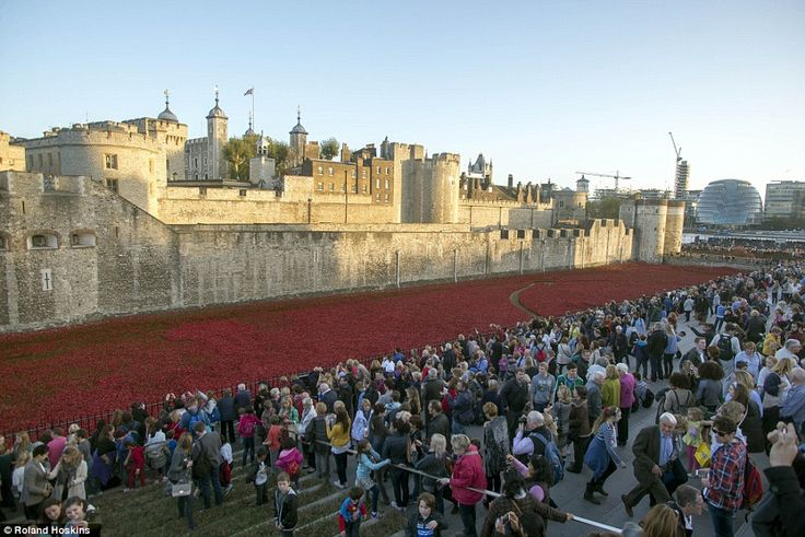 Moving: Thousands of people have gathered at the moat surrounding the Tower of London to s...