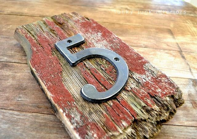 Take old fence posts or other weathered wood and create individual numbers for your address or other purposes.