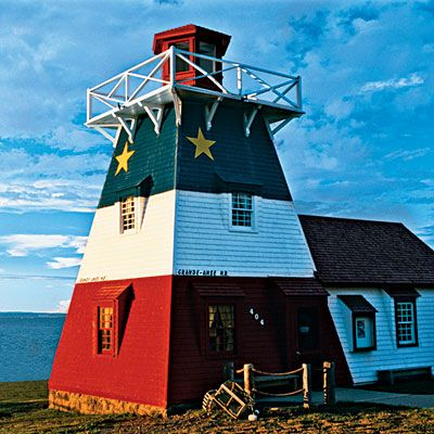 This New Brunswick lighthouse sports the colours of the Acadian flag. Now used as a tourism center, it stands on the edge of the Bay of Chaleur on Route 11 in Grand-Anse.