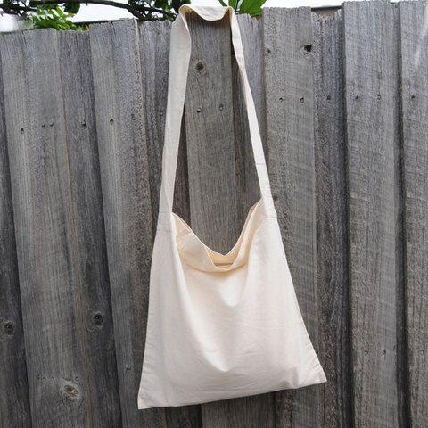 Plain shoulder bags in natural or black. 100% cotton calico, $4.40