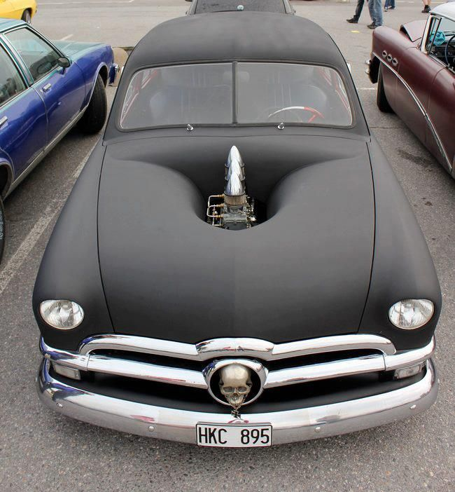 50 Ford rat rod,.......there is really some true art work in that hood!
