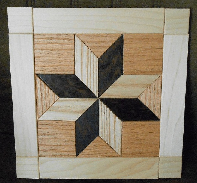 A Lovely Quilt Design Made From Wood Wall Hanging This