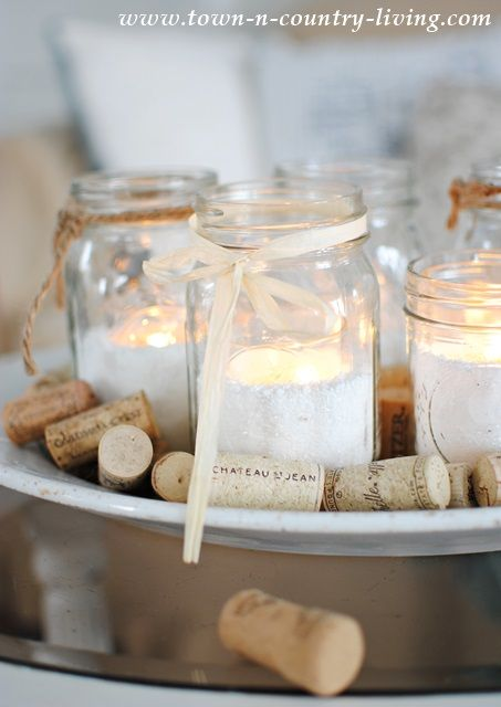 "Mason jar candles with epsom salt as ""snow"" with raffia and twine bows on a tray with wine corks for texture.  Love this look!"