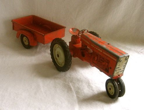 Vintage Tru Scale Tractor and Trailer Farm Toy Model by VivaVera, $28.00.....My great great grandmother Frances Lay worked in Dubuque, Iowa at Carter Machine and Tool Company (She worked there from 1948 to the 1960's, at the latest), a toy factory where they produced a lot of the Tru-Scale merchandise...anything from toy/model disc harrows to tractors and wagons, probably like the one shown here!