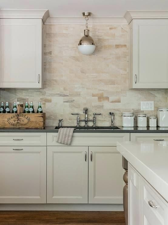 Tan Backsplash Tile A Small Hicks Pendant Is Mounted In