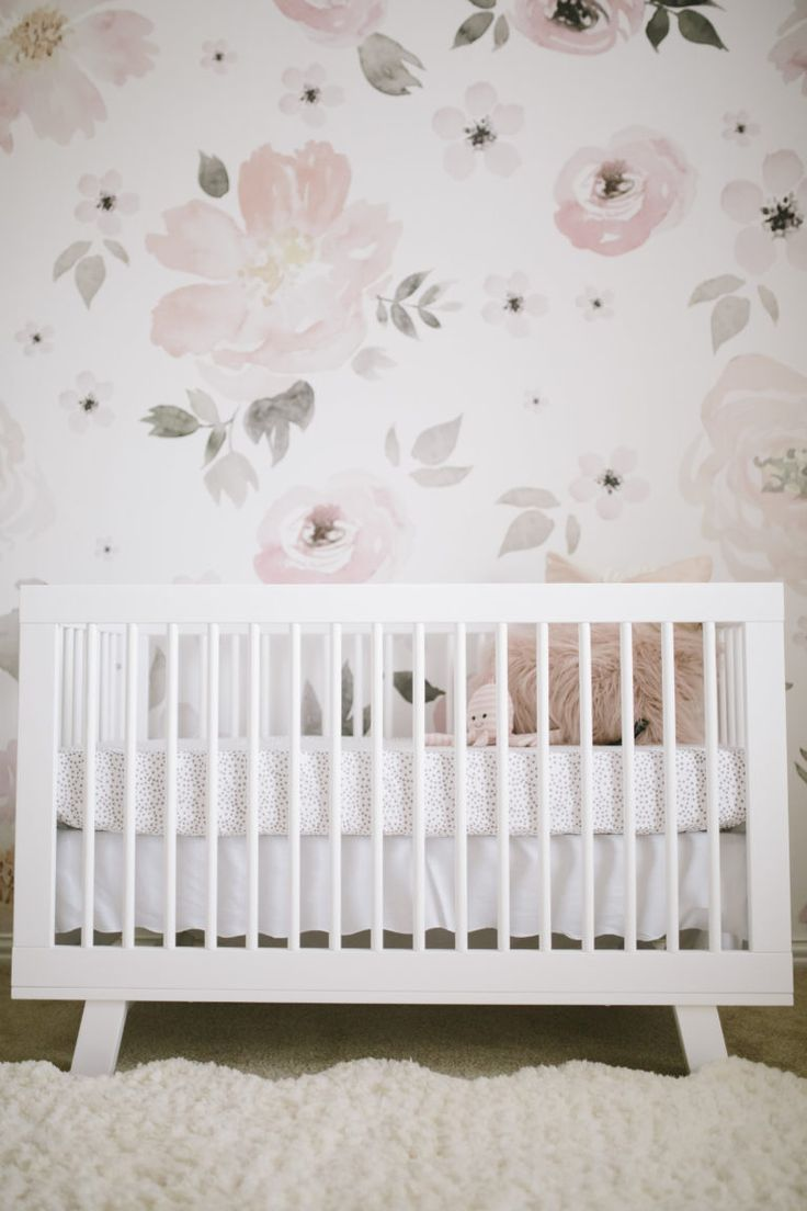 Modern Crib in a Floral Baby Girl Nursery - we love the clean lines of the @Babyletto Hudson crib paired with this whimsical floral design!