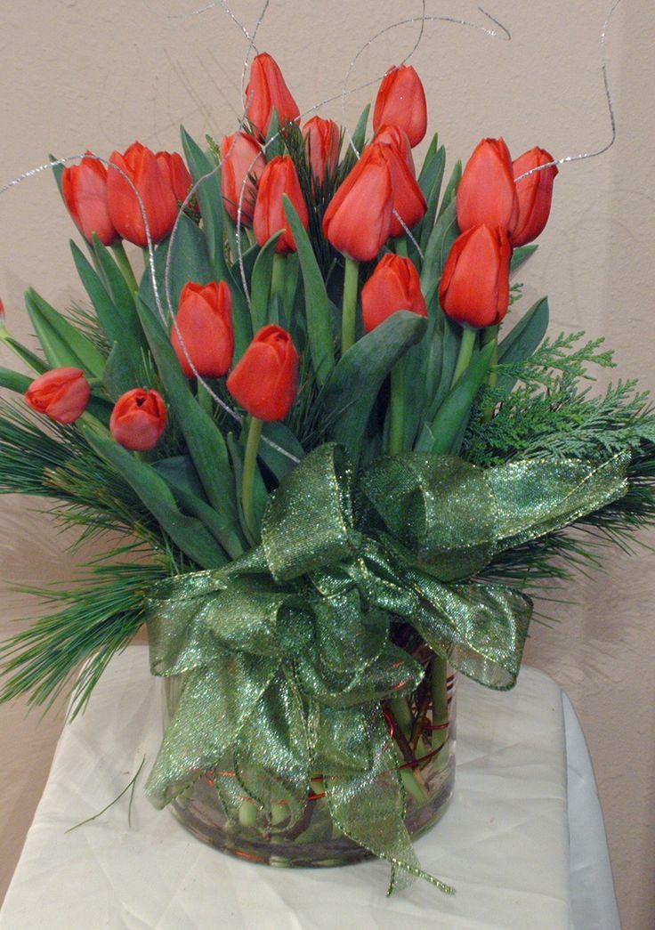 Holiday Centerpieces using red tulips and green accents