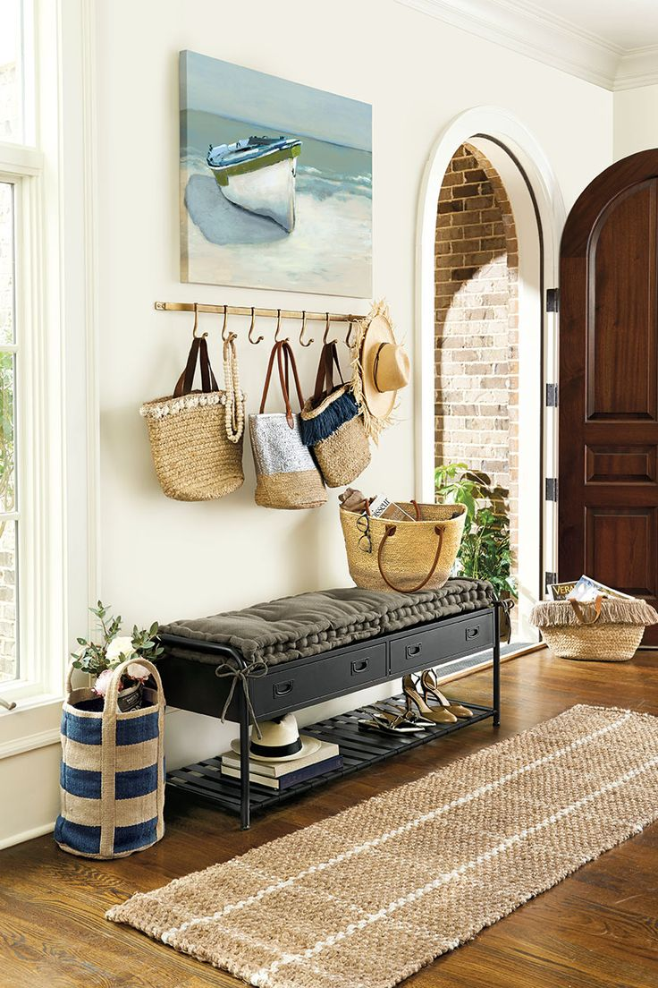 Instant entryway? Hooks for bags and coats, a natural fiber runner that hides dirt, and a storage bench with shelves and drawers! Voila!