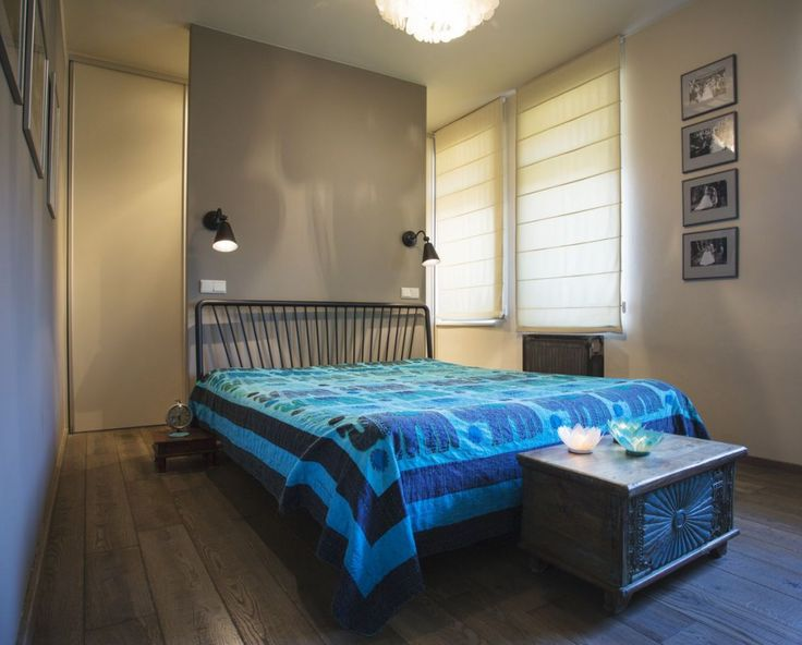 Oriental table designed by Le Patio and blue bed cover