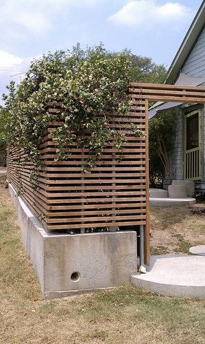 Horizontal slats with poured concrete base.