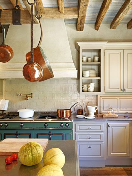 Pretty European Kitchen with copper and a La Cornue... Love this!