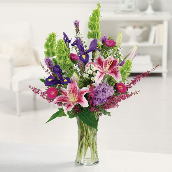 Google Image Result for http://www.wedding-flowers-and-reception-ideas.com/images/stargazer-lily-02.jpg