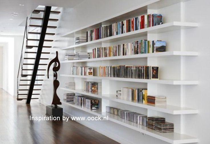 Inspiratie boekenkast van www.oock.nl Een kast waarbij het lijkt alsof er legplanken aan de muur zijn gemonteerd