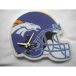Show your team spirit with a Denver Broncos clock Football collectible is shaped like a helmet Sports memorabilia is ideal for the football fan in your life