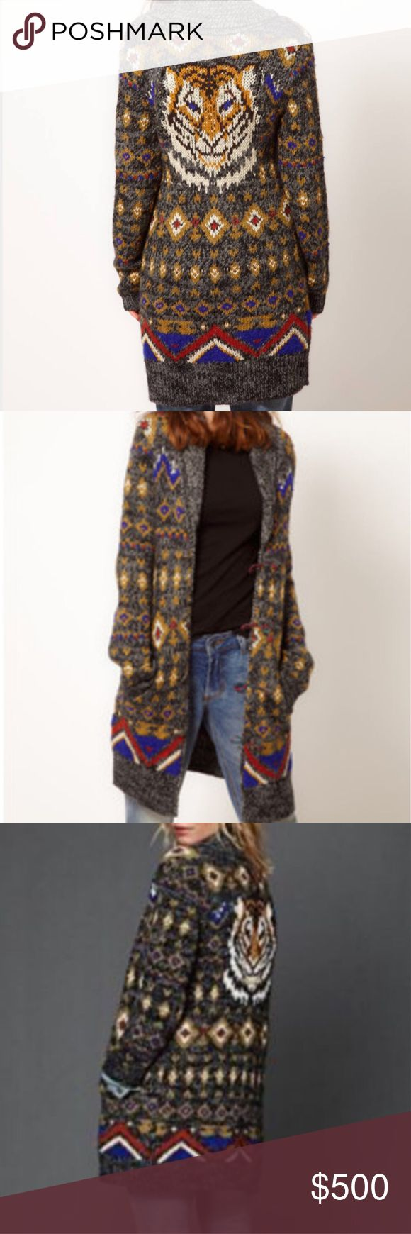 Gorgeous Free People Fierce 🐯 Duster This boyfriend cardigan by Free People is made from a super soft wool blend. The details include: a jacquard knit design with tiger motif to the reverse, folded collar, engraved buttons with twisted loop closure, pockets to the hips and a wide ribbed hem. The cardigan has an oversized fit. 100% Other fibres. Excellent like new condition. As seen on Pretty Little Liars. A rare find! Sold out in stores! **COMING SOON please like to be notified of arrival…