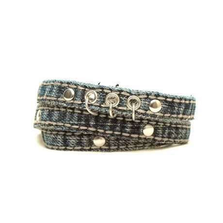 Blue denim chic! A very fun blue denim wrap-around bracelet accented with studs, grommets and decorative metal rings. For easy, casual days!  Triple wraps easily around a 7-7.5 (17.75-19 cm) wrist.  Bracelet total length when unwrapped, including clasp: 25.5 (64.75 cm) Width: just under .5 (1.25 cm)  All raw edges have been treated with a fray inhibitor, however some fraying is to be expected as a result of the beautiful life-cycle of denim.  As always, individually re-purposed and packaged…