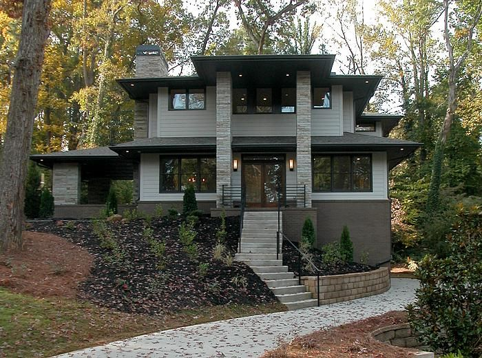 A custom built Modern Prairie style home in the LaVista Park neighborhood of Atlanta.  This home features five bedrooms and three-and-a-half baths.  The exterior is composed of brick, stone and Hardiplank siding.  The home has a side porch with outdoor gas fireplace.  Designed and Built by Epic Development