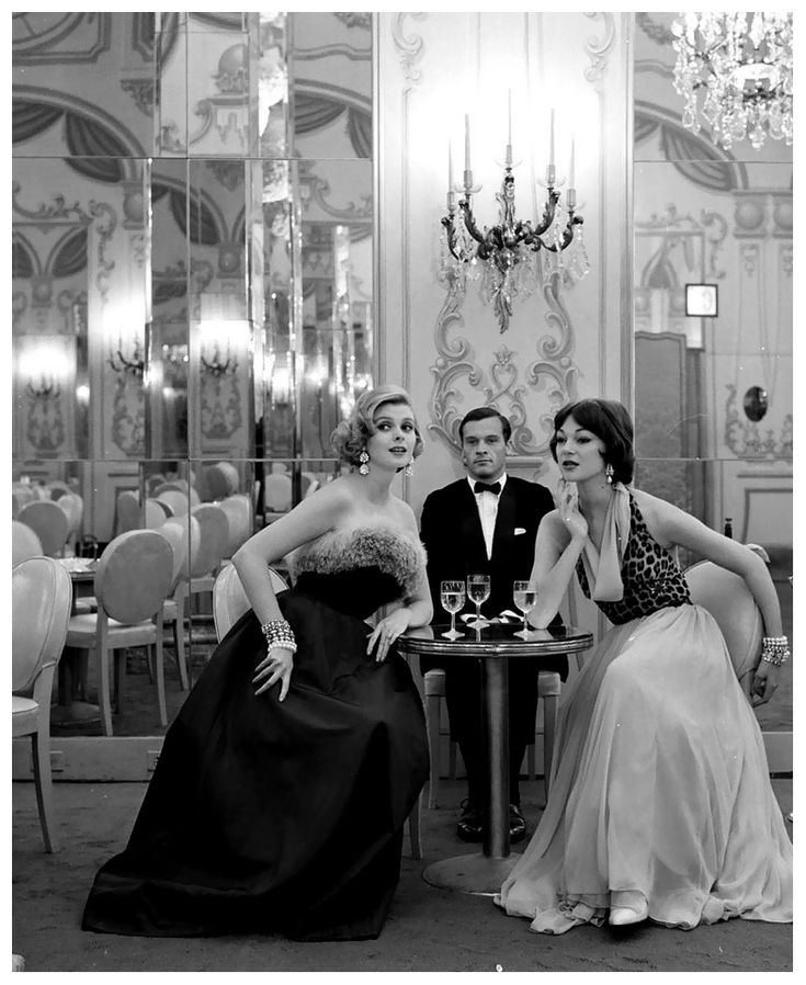 Model in Pauline Trigere's silk ball gown and Ivy Nicholson in Anna Miller's leopard halter-top chiffon dress.  Photo by Nina Leen, 1957