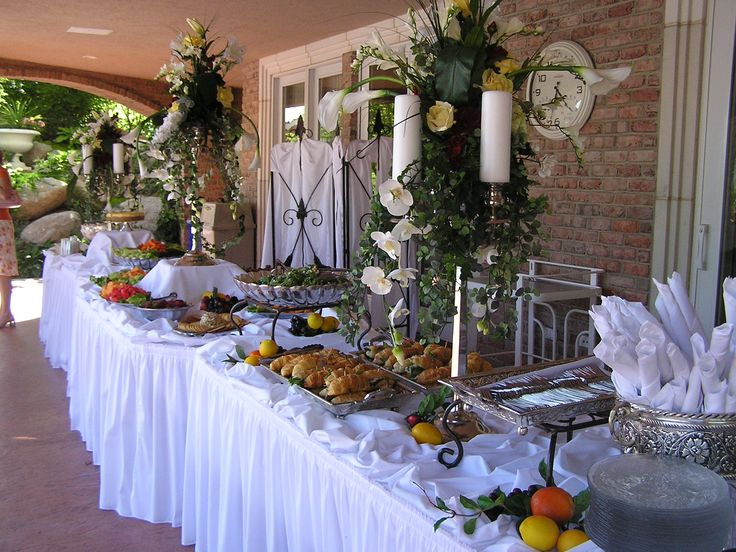 christmas buffet table decorations pictures | White banquet table, pleated skirt & beautiful serving ware