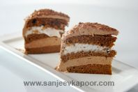 Frozen Chocolate Mousse Cake: Chocolate cake layed with chocolate cream and vanilla icecream.