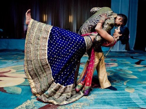 A nice moment captured, along with the beauty of the lehenga!