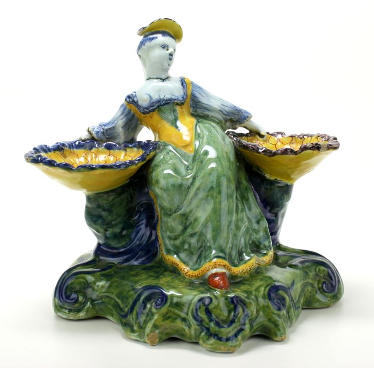 Delft polychrome salt with a sitting lady in a long dress holding two shell shaped baskets,  ca. 1750, collection Doodeheefver,  Height: 15 cm, Jeroen PM Hartgers