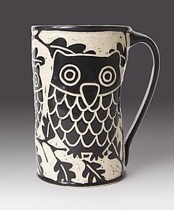 """""""Owl Mug"""" (Ceramic Mug) Created by Jennifer Falter. A whimsical wheel thrown ceramic mug, decorated with sgraffito using black slip, featuring an owl perched in the branches. Glazed to give a glossy finish. Each piece is unique, and will vary slightly from piece to piece. Dishwasher and microwave safe; holds approximately 16 oz. http://www.artfulhome.com/product/Jennifer-Falter/Owls-Mug/52191"""