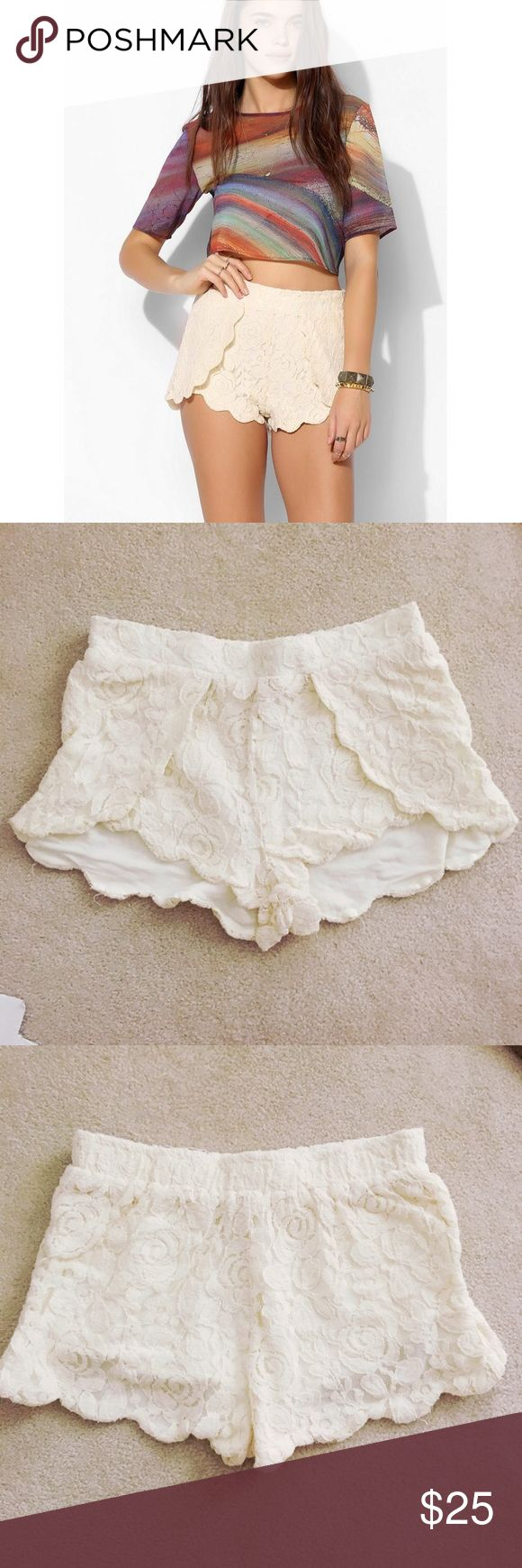 """Urban Outfitters Lace Shorts Cream lace shorts with scalloped detail along angles legs and overlaid front. Gathered elastic pull-on waistband. Front- 10""""L. Back - 12""""L. Waist- 13"""" across. Urban Outfitters Shorts"""