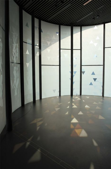 A glass facade scatters triangular patterns of light and shadow created by the wind in this installation at Now Gallery London by designer Simon Heijdens.