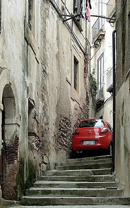 Cosenza, Calabria, Italy // by Pom' on Panoramio - Are they parked or are they stuck there?