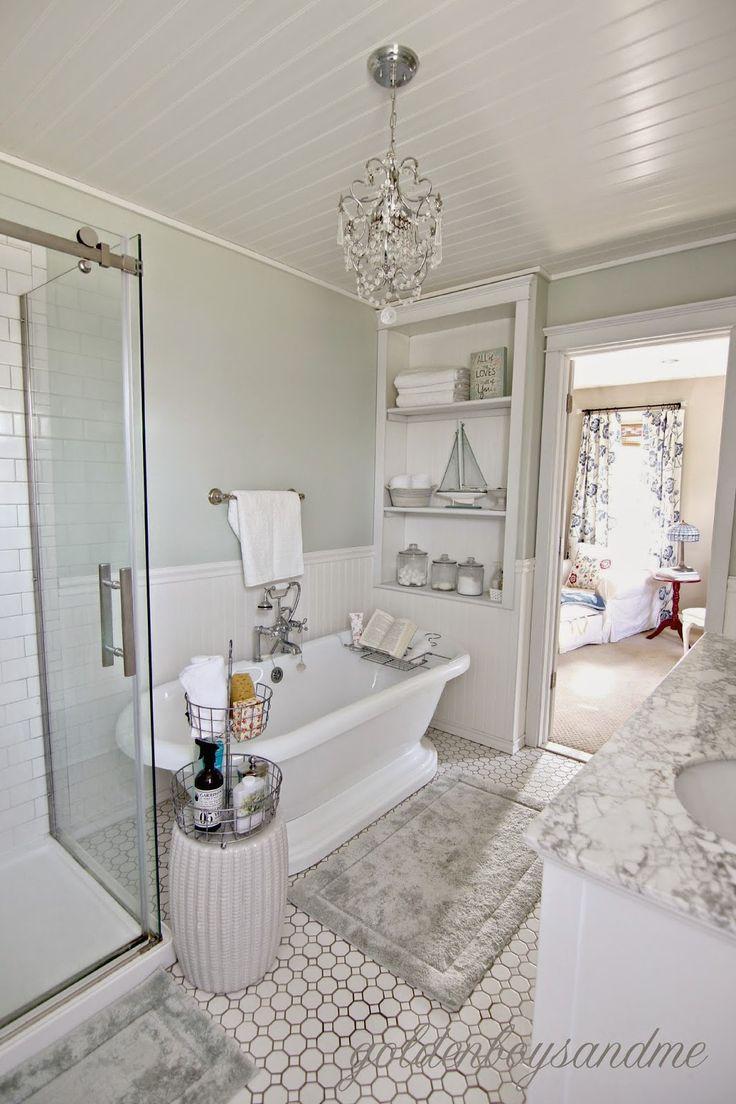 DIY master bathroom with pedestal tub, chandelier, and built  ins-www.goldenboysandme