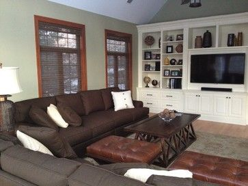 dark brown sofa with dark coffee table and white entertainment
