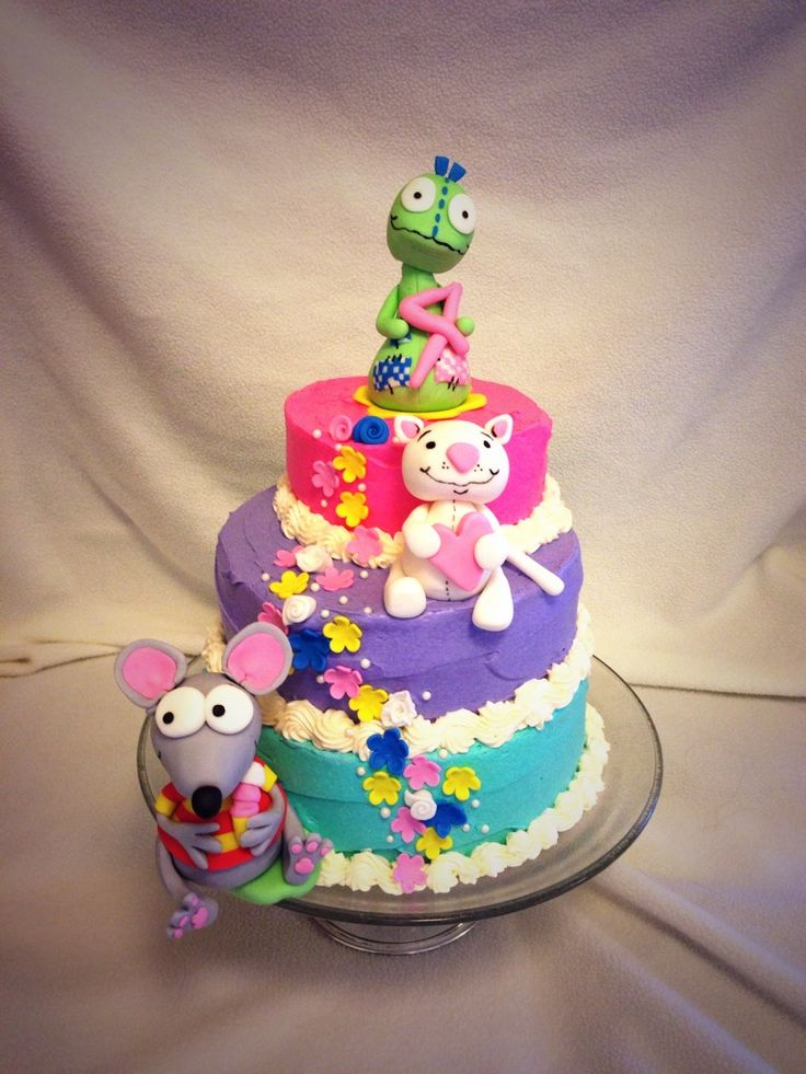 My daughter's 4th birthday cake with custom made Toopy, Binoo and Patchy Patch