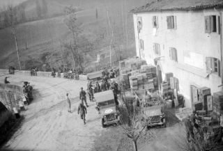 Division 2nd Battalion 85th Regiment stand near a stock of ammunition at Gaggio Montano