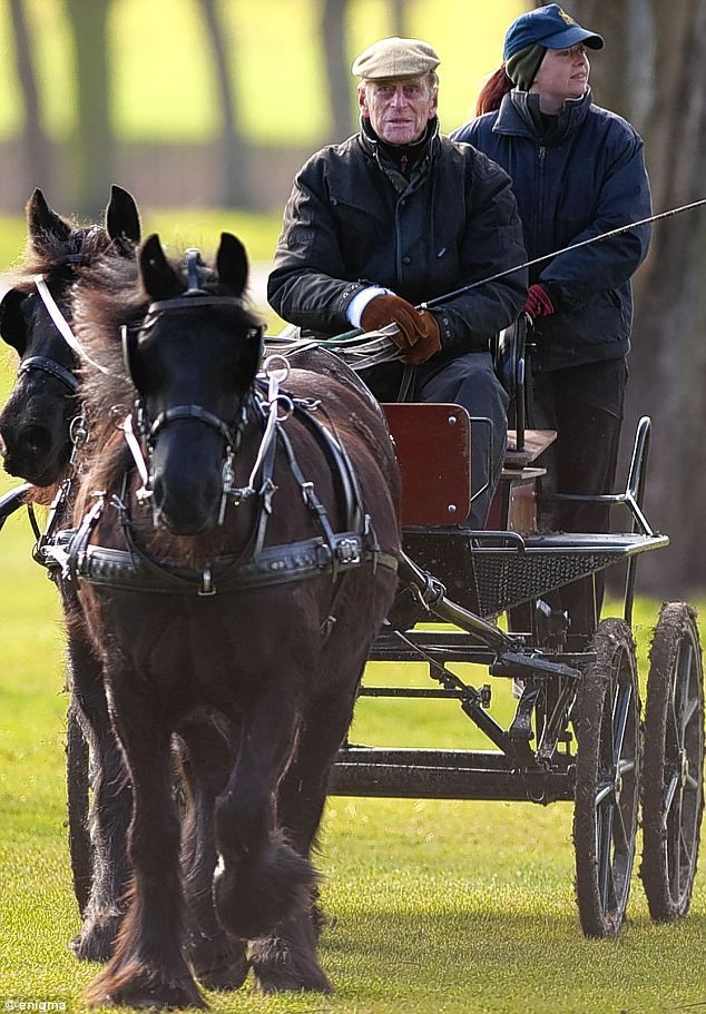 Back in the driving seat: A groom rides shotgun as Philip goes for a leisurely spin in Windsor Great Park yesterday, just nine weeks after heart operation.