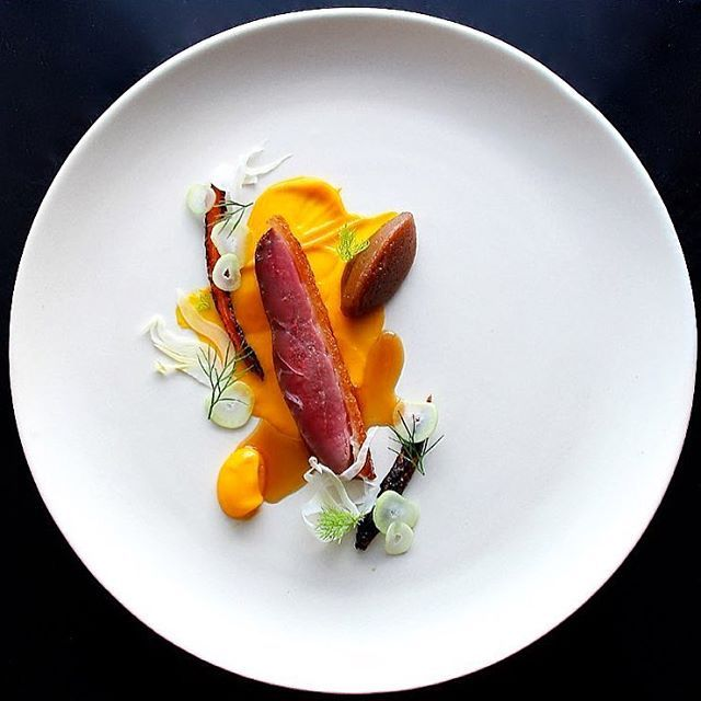Fennel juice brined duck breast, roasted date jam, carrots cooked in carrot juice then charred and par dehydrated, carrot purée, pickled fennel and star anise jus by @seanymacd @rafacovarrubias #GourmetArtistry