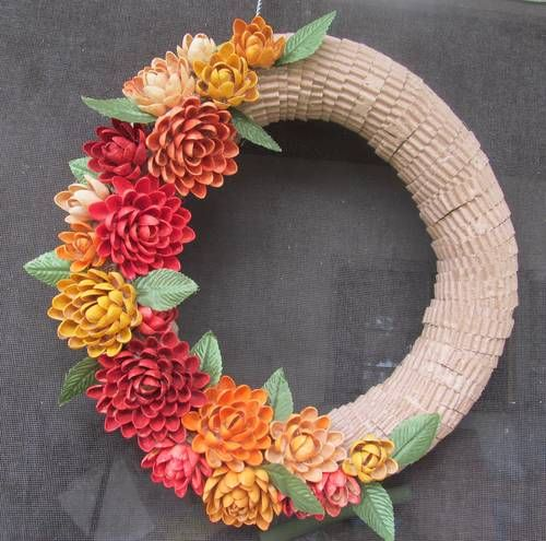 My $1 Autumn Wreath - MISCELLANEOUS TOPICS:  Wow, she used a one dollar swim noodle, left over pistachio shells and a few fake leaves.  Painted pishtachio shells with diluted acrylic paint.  !!!